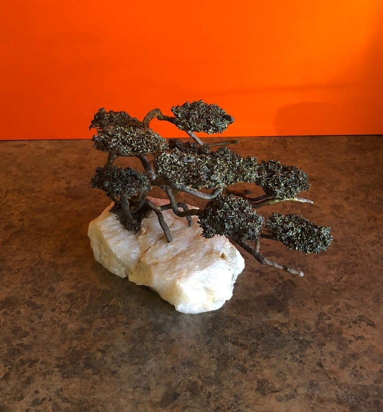 A very nice midcentury Bonsai tree sculpture of brass and bronze on a rugged onyx base by Mario Jason, circa 1970s. The piece is signed and still has its original tag attached.