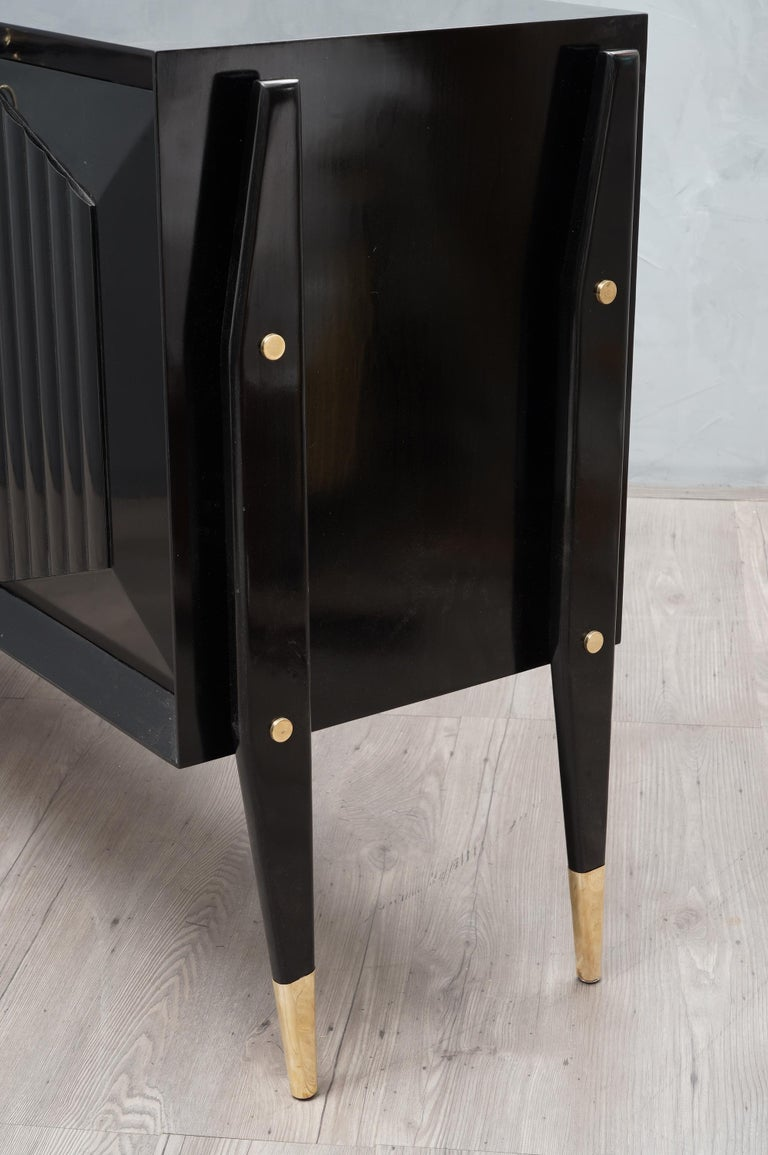 Italian Midcentury Brass and Black Wood sideboard, 1950