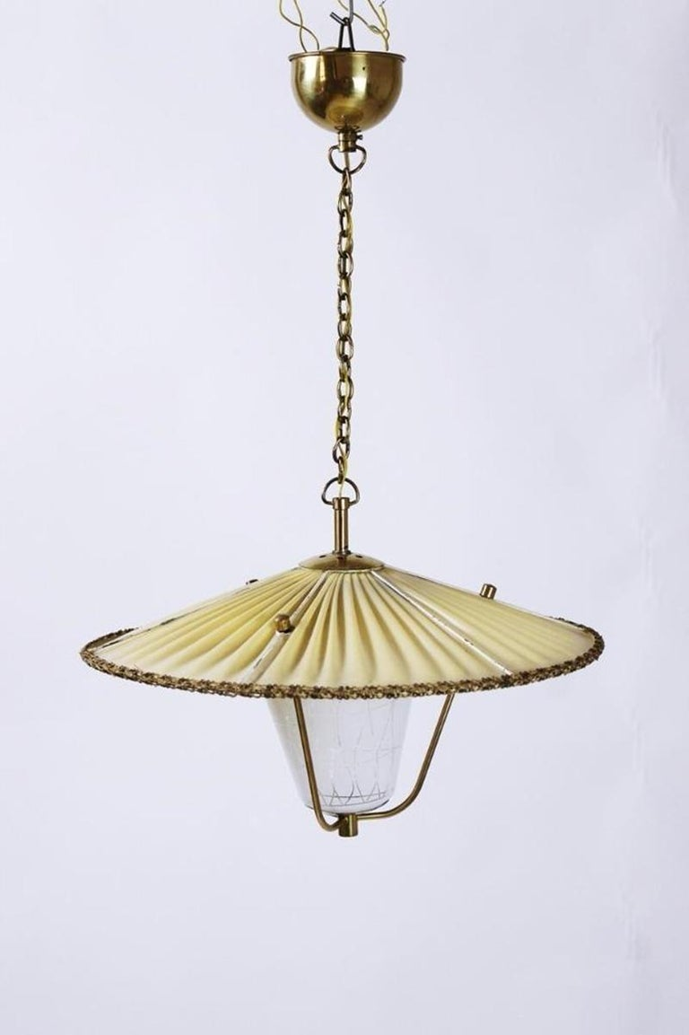 Vintage Austrian origin lantern pendant light, manufactured in early 1950s. A beautiful, Chinese hat inspired piece with a opaline glass lampshade. In very good condition with nice patina on the brass. High quality of