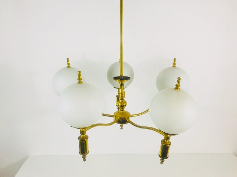 Brass chandelier in the style of Maison Lunel from the 1950s.  The light requires E14 light bulbs.