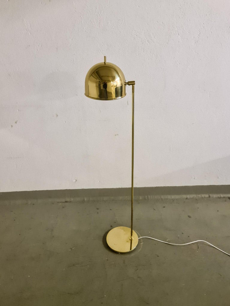 This floor lamp made by Bergboms Sweden in the 1960s made in brass has that iconic look.   Good working vintage condition, all new wiring. Small dents on base.  Measures: H 130 cm, W 20 cm, D 25 cm.