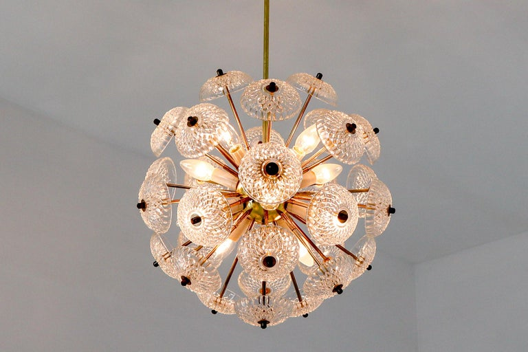 Midcentury brass floral chandeliers in the style of Emil Stejnar. ( 12 x on stock ).  Made of brass with stylish floral glass disc glass light diffuses. The lamp is covered with art glasses which scatter the light in a unique and very charming way