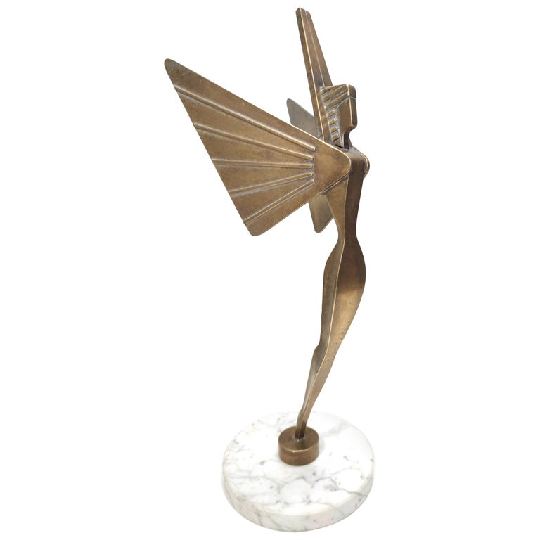 Midcentury Brass Nike Decorative Object with a Marble Pedestal For Sale