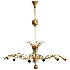 Midcentury Brass Sixteen-Arm Chandelier in the Manner of Guglielmo Ulrich Italy
