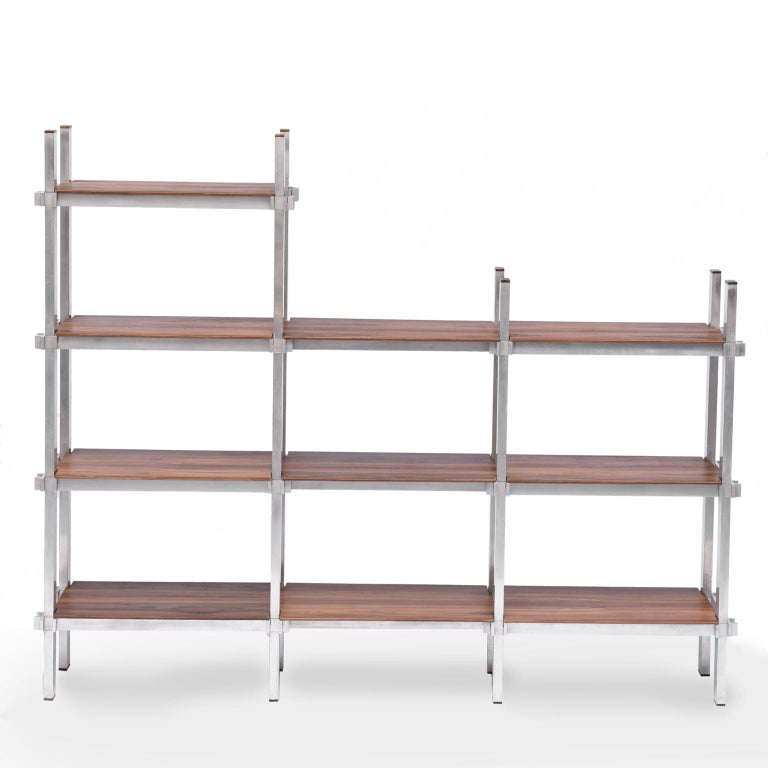 Midcentury Brazilian bookcase with structure in aluminum and plywood, 1960s  Bookcase structure composed of plywood with aluminum structure, supporting three shelfs and a fourth shelf.