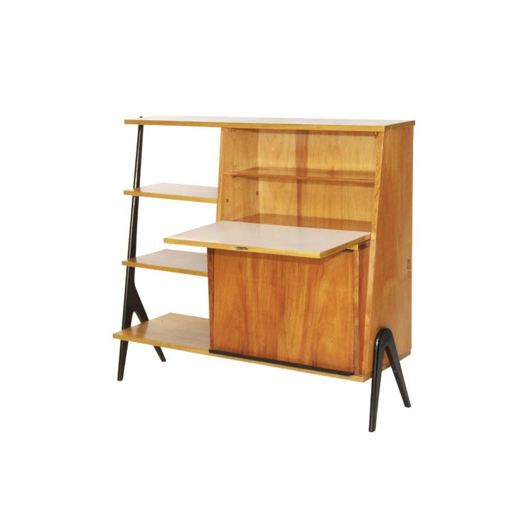 Midcentury Brazilian bookcase with caviúna wood structure, 1960s  In caviúna wood structure, this bookcase has two storage spaces with doors. One of the doors becomes an artboard for small jobs. Its black feet give the highlight in every beauty of