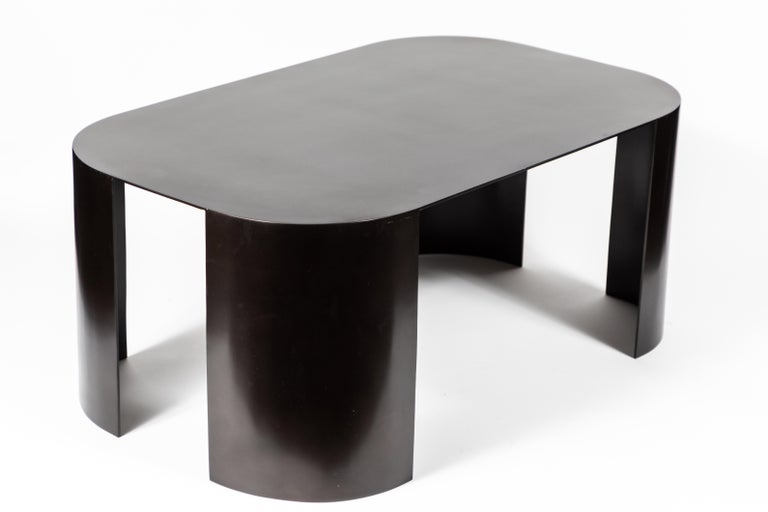 Beautiful coffee table in bronze-plated steel in the manner of Karl Springer. The table's clean lines and size make it a versatile piece in many spaces.