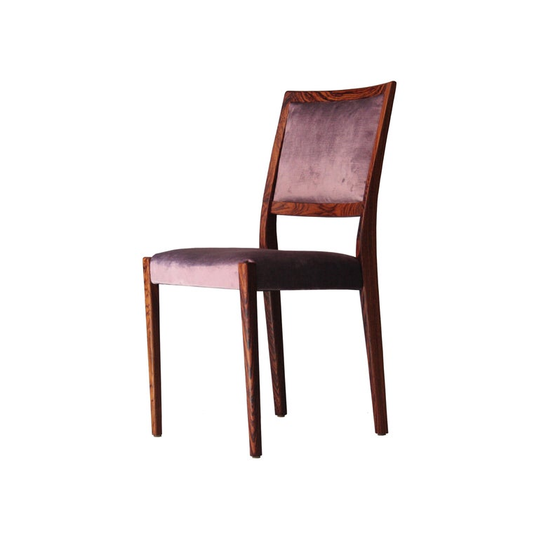 Set of four chairs. Structure made of solid wood, with seat upholstered in purple cotton velvet.