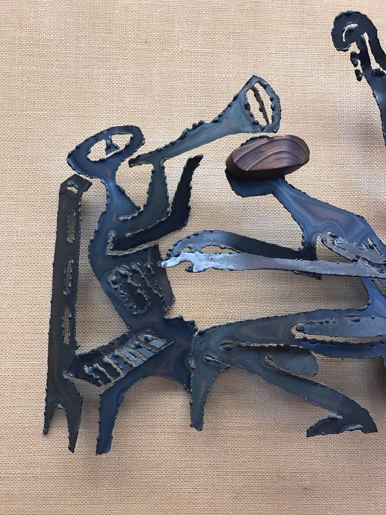 Stunning, unsigned Brutalist metal sculpture on linen. Features a jazz quartet motif.