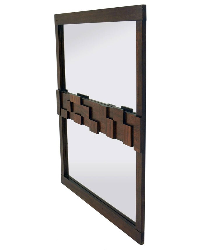 Midcentury Brutalist mirror by Lane, American, circa 1960s. This piece retains it's original medium brown finish. If you prefer, we can refinish it in the color of your choice, including solid lacquer colors like white, for an additional $250.