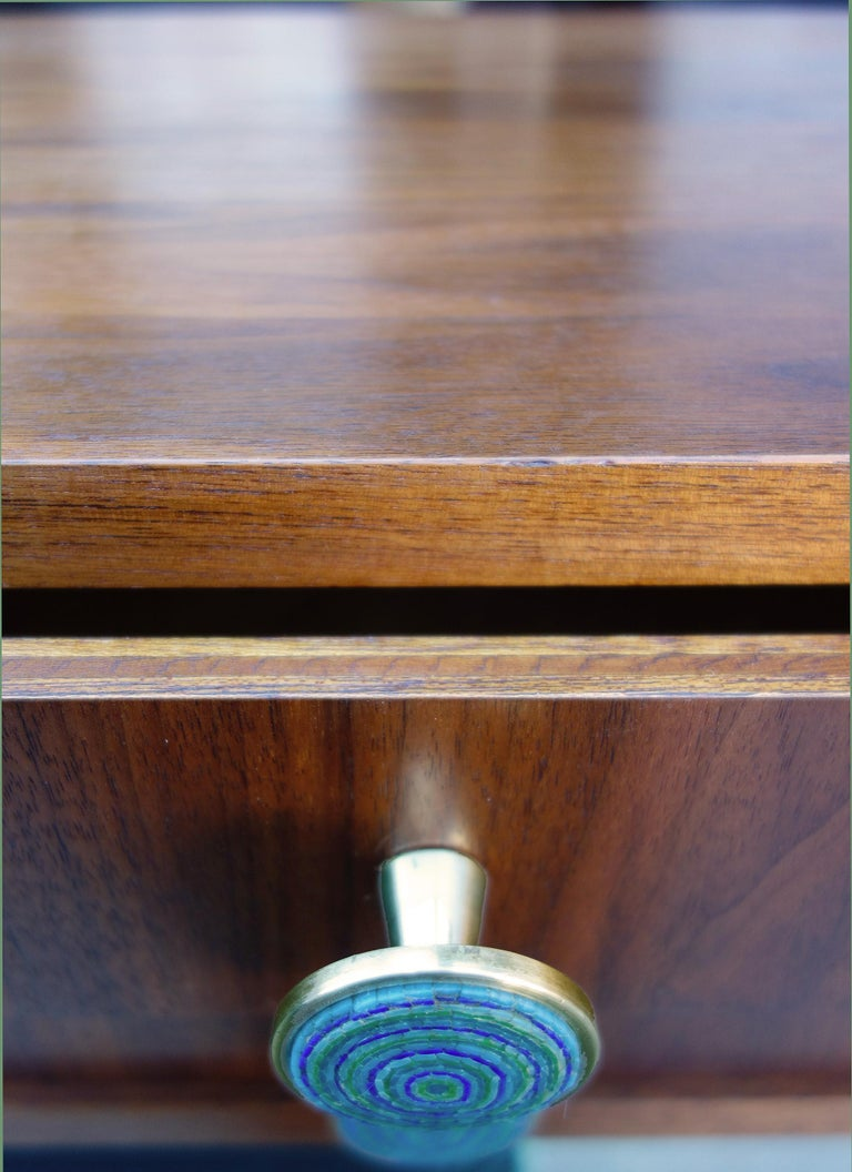For your consideration are these simply beautiful miniature set of drawers featuring black walnut and brass pulls. The cabinet was crafted in Finland and the knobs are made in Italy designed by Evelyn Ackerman with blue micro mosaic inlay. These