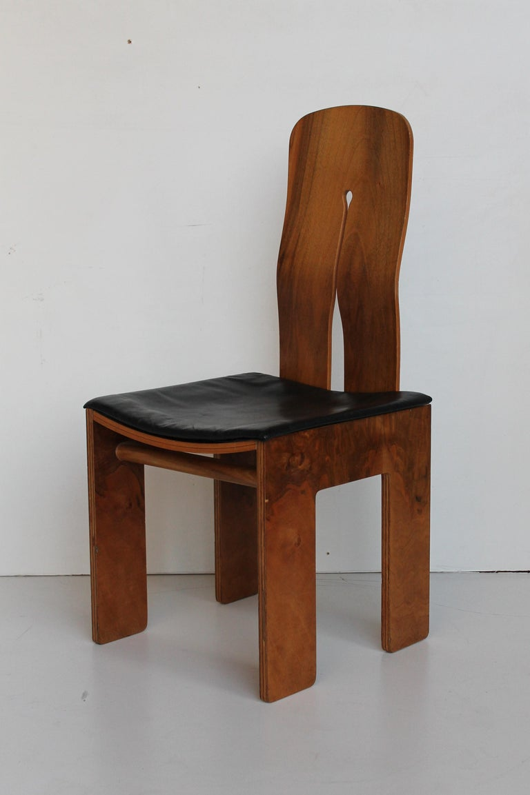 Four Carlo Scarpa walnut and black leather chairs mod. 1934/765 for Bernini, 1977.