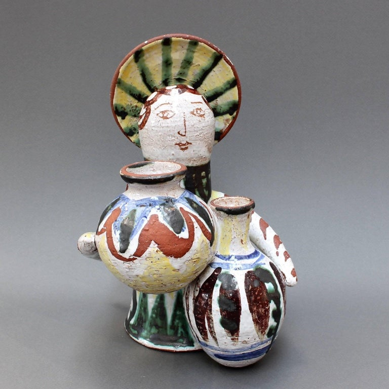 Midcentury ceramic angel with amphorae sculpture (c. 1950s). This beguiling ceramic piece was discovered in the south of France. Probably should be attributed to one of the Vallauris ceramicists, it is simply marked 'R' on the inner base of the