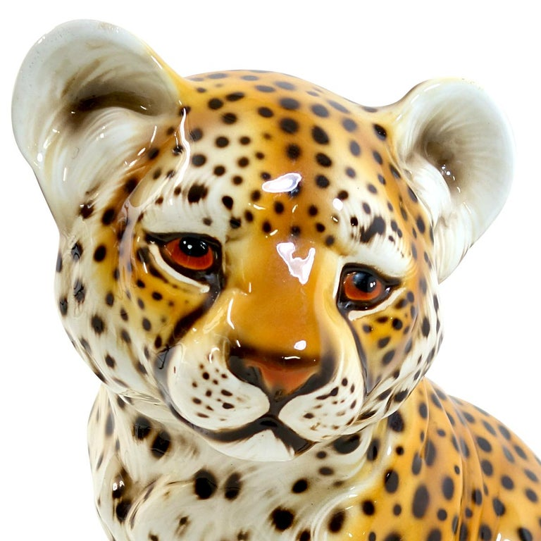 Very cute sitting panther cub made of cast ceramic.