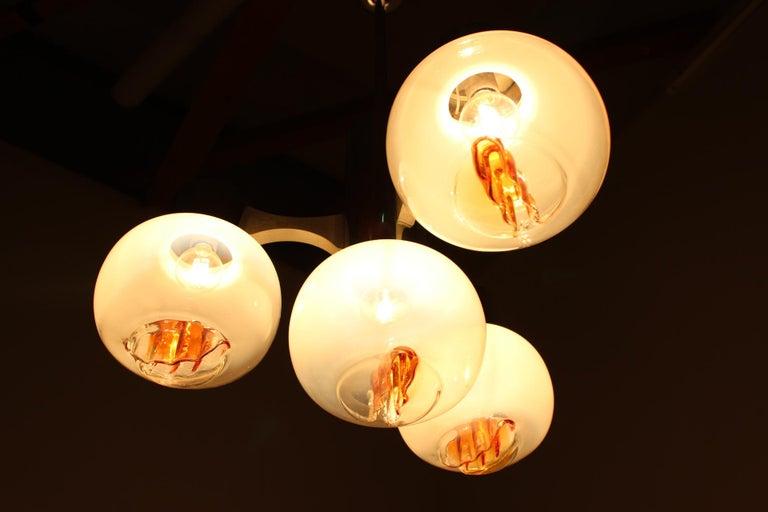 Chandelier. Pendant light. Very nice style of lighting. Four Murano glass balls.