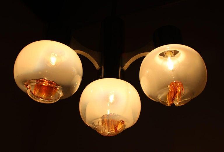 Chandelier, pendant light very nice style of lighting. Four Murano glass balls.