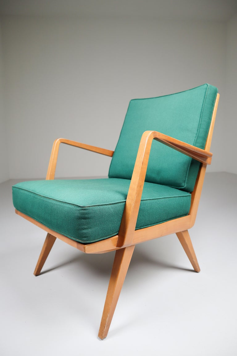 Midcentury armchair manufactured and designed by Walter Knoll