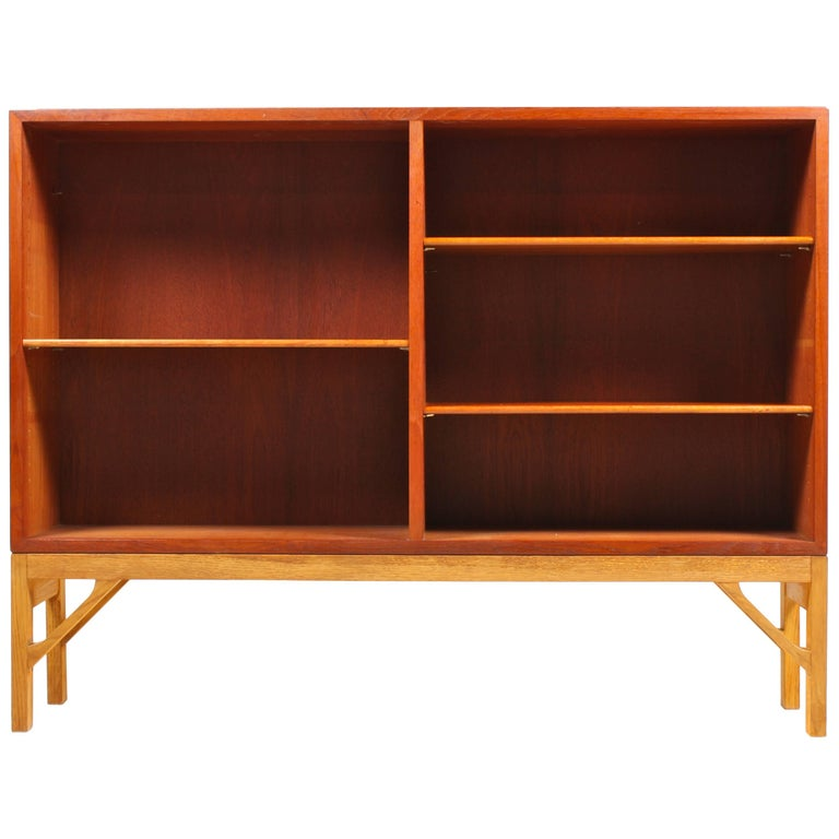 Low China bookcase in teak on a solid oak base. Designed by MAA. Børge Mogensen in 1958, this piece is made by CM Madsen cabinetmakers Denmark in the 1960s. Great original condition. More shelves available.
