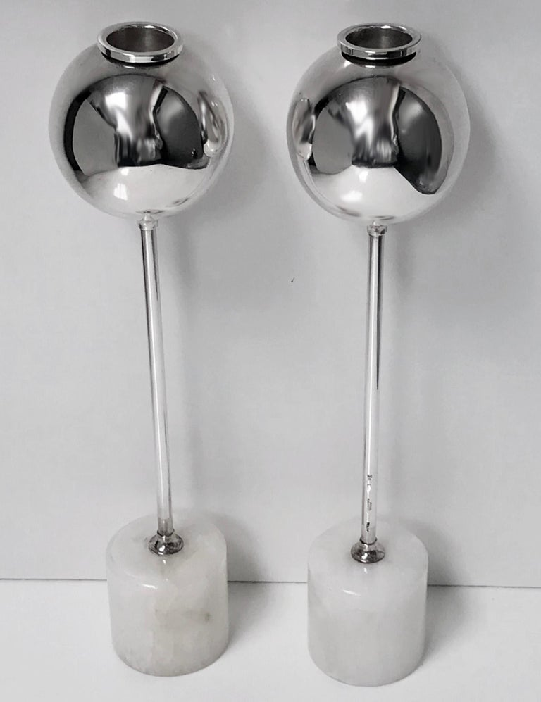 Midcentury Christofle rare design candlesticks, convertible to vases. Each of spherical form on long tubular stems surmounted on white marble cylindrical bases. Stems with full Christofle Gallia marks. Nozzles removable to allow for use as vases.