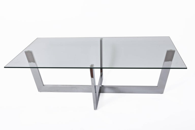 Wonderful chromed steel coffee table with crystal glass top. This amazing piece was produced in Italy during 1970s.   This midcentury masterpiece of minimal design is lovely because of the straight lines of both the glass top and chrome steel