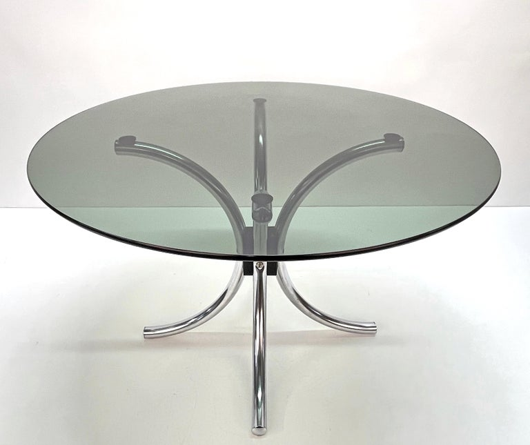 Beautiful coffee table in chromed steel with smoked round glass top. This fantastic item was produced in Italy during the 1960s.  This atomic-style Italian coffee table features a base made of four chromed metal tubes and a smoked glass top.  A