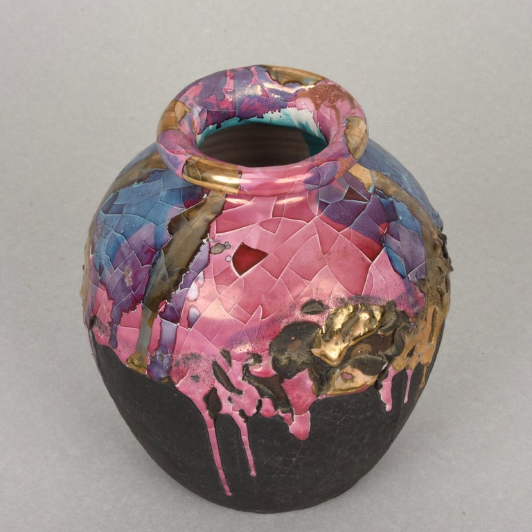 This polychrome ceramic vase is a marvellous production by Claudio Pulli, one of the greatest Sardinian artists of the 20th century.  The vase was produced for I.S.O.L.A. and is made of enamelled ceramic, coloured with nail polish with metallic