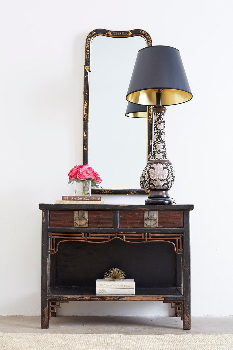 A rare midcentury Chinese cloisonné table lamp made of a long neck bronze vase decorated with a floral foliate pattern in shades of pink over a dark texture diamond pattern background. Sold by Wilshire House of Beverly Hills, CA. No shade included.
