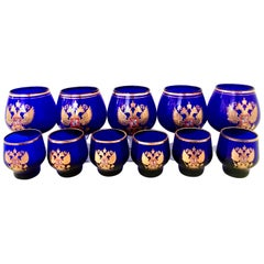 Midcentury Cobalt and 22-Karat Gold Coat of Arms Bohemia Glass Drinks Set of 11