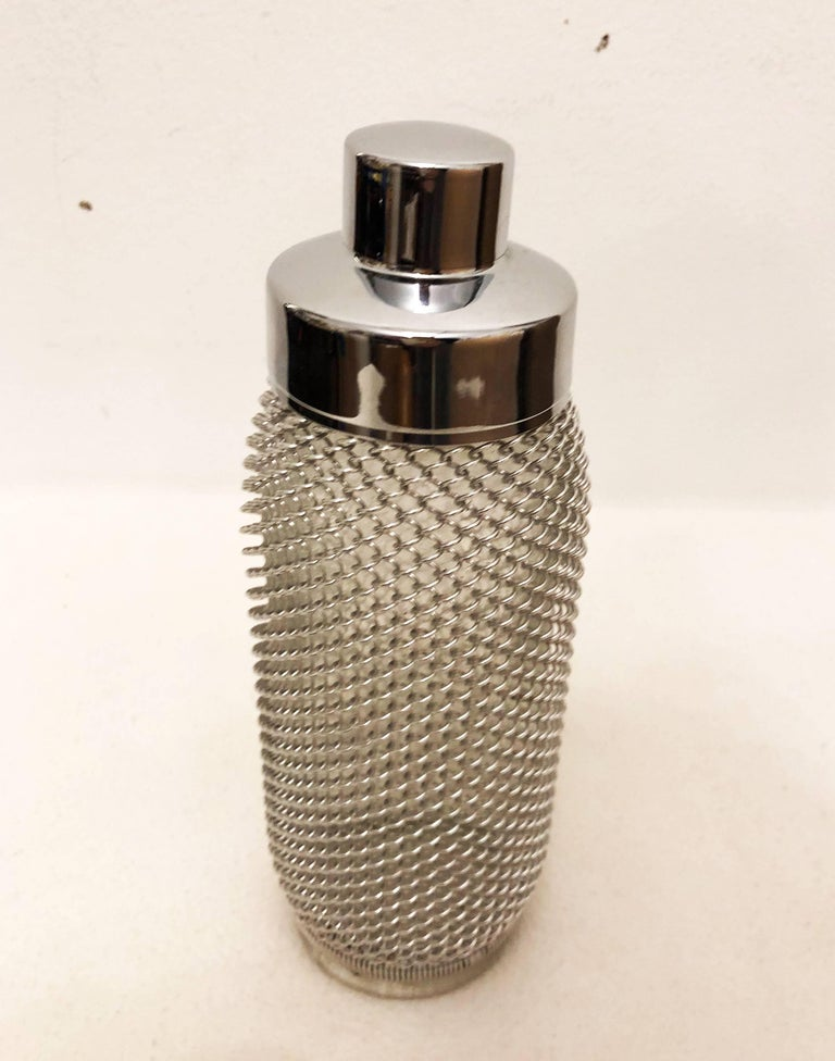 Glass bottle with wire-netting and a cover made in the early 1970s.