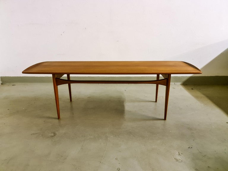 This teak coffee table with sleek lines and solid construction was manufactured in Denmark during the 1960s. Designed by Tove & Edvard Kindt Larsen and manufactured at France and Daverkosen this a great example of the simplicity and elegance that