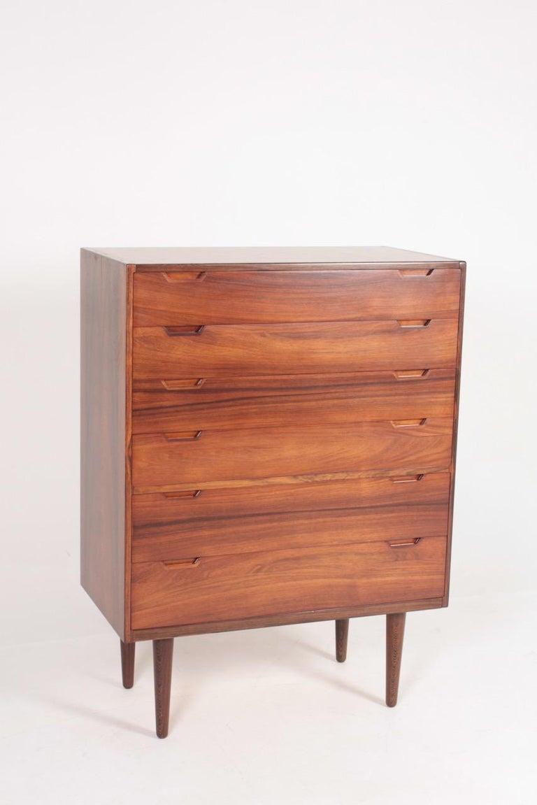 Elegant commode in rosewood designed by Svend Langkilde M.A.A., made in Denmark. Great original condition.