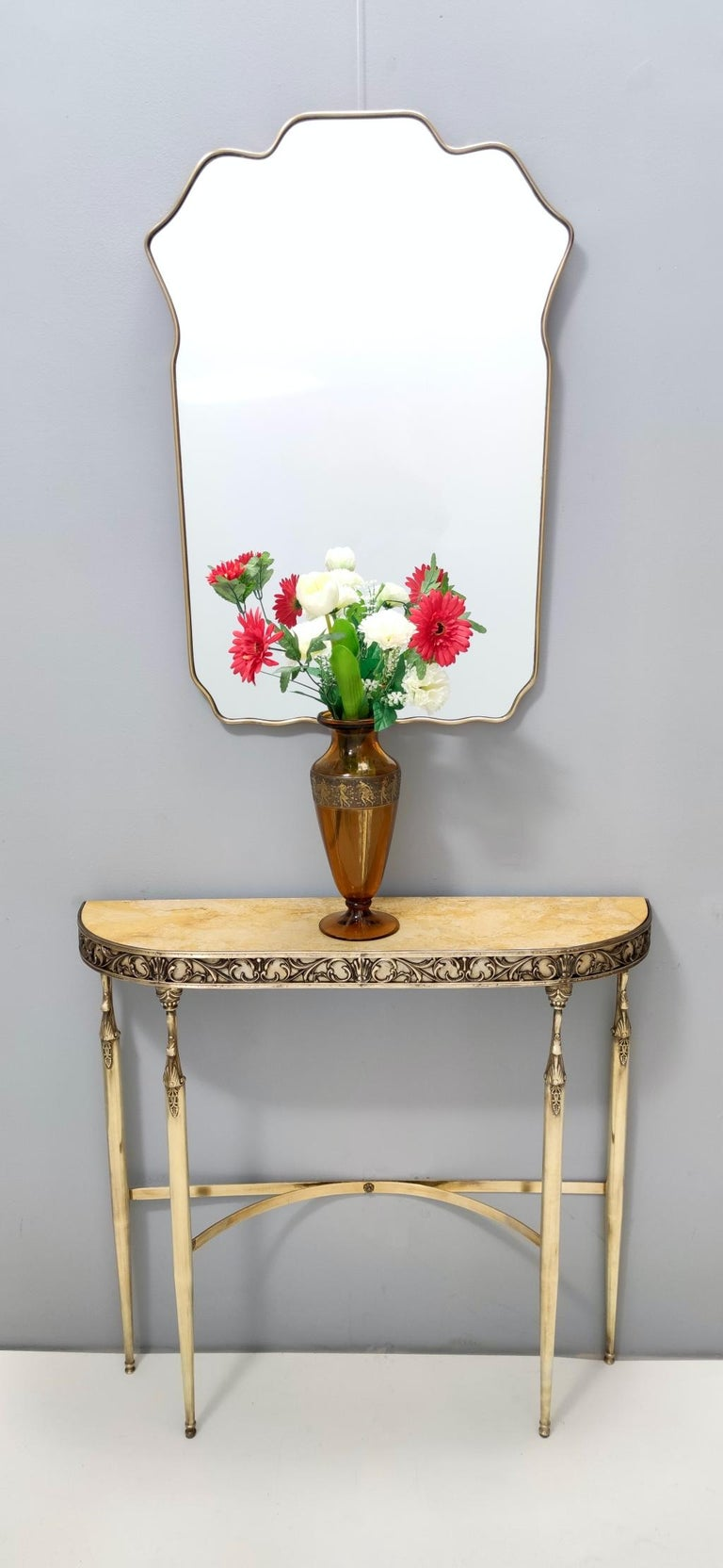 1950s. This console table features a 4.7- centimeter thick royal yellow marble top and a brass frame.  It is a vintage item, therefore it might show slight traces of use, but it can be considered as in excellent original condition and ready to