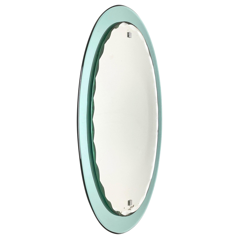 Mid-Century Italian Cristal Arte carved oval mirror, framed, Italy 1960s