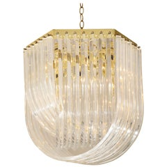 Midcentury Curved Lucite Ribbon Chandelier in Brass
