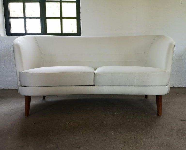 This sofa and chair were made at Olof Persson Fåtöljiundustri in Sweden during the early 1950. The curves on this furniture is amazing. The sofa and chair are both reupholstered with new fabric made in Sweden and work made by professional.