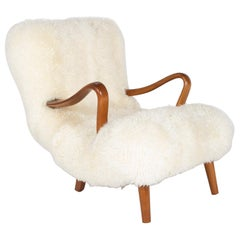 Midcentury Danish Chair of Elm Wood and Sheepskin in the Style of Arctander