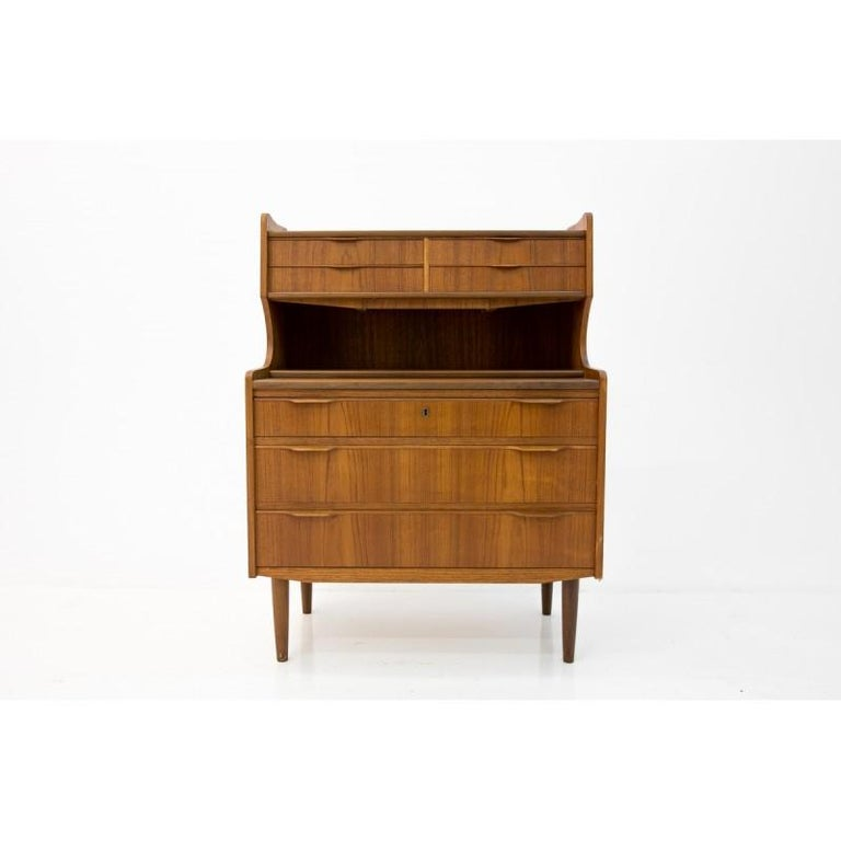 Unique item, shape looking as secretary desk with pulled writing surface, hides small size original mirror. Can be used as vanity as well. Three spacious drawers at the bottom and small at the top. Preserved in teak very good condition. After