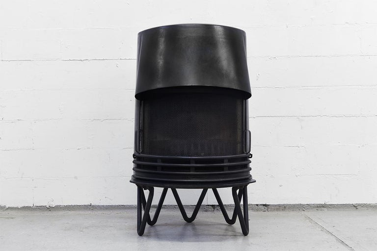 This wood stove was designed by architectural firm Hoff & Windinge for Tasso Denmark, circa 1942. The fireplace has a removable grate, Hairpin legs and is marked Tasso Denmark This a real Modernist piece.
