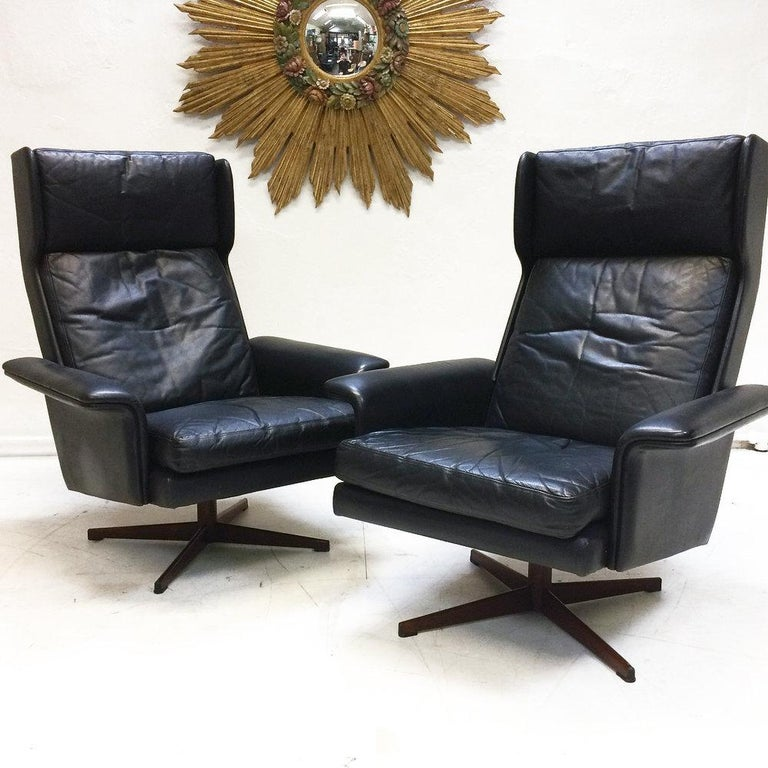 A superb 1960s leather lounge suite by Komfort Denmark, designed by HW Klein. Comprising of a four-seater sofa and two high-back chairs. The leather is in beautiful original condition, soft supple and gently creased showing minimal signs of wear.