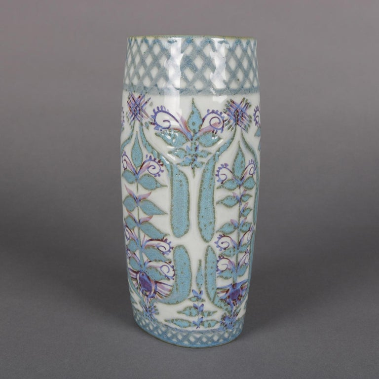 Midcentury Danish modern hand-painted Royal Copenhagen Aluminia Faience porcelain vase features all-over stylized floral and foliate design, Danish heavy porcelain painted vase, marked with beehive and artist signed Marianne Johnson on base, 20th