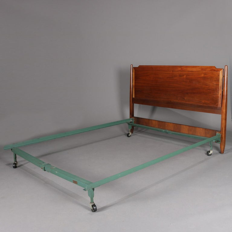 Midcentury Danish modern full/double bed frame features panelled walnut headboard having flanking turned column supports and collapsible metal frame, 20th century.  ***DELIVERY NOTICE – Due to COVID-19 we are employing NO-CONTACT PRACTICES in the