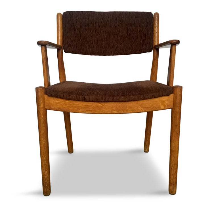 Danish design, oak and fabric armchair.  Original vintage condition, cleaned and oil-restored  This model was designed in 1954 by Poul Volther for FDB and was published in their 1955 catalogue (the photos are from the catalogue)  Measures: H