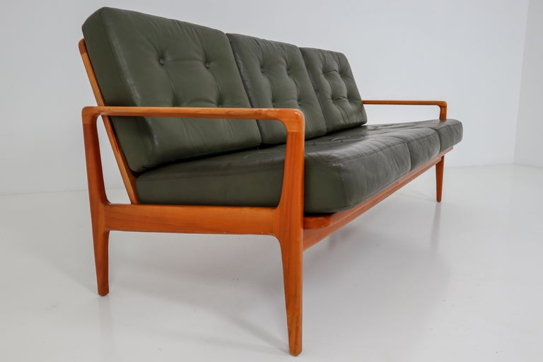 Midcentury Danish three-seat sofa by Arne Wahl Iversen, 1960s. Original cushion in green leather in very good condition.