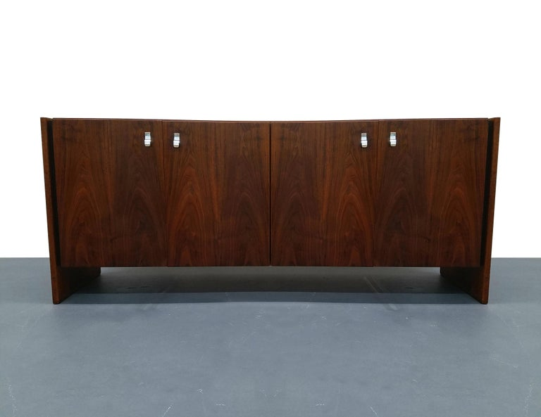 Beautiful midcentury walnut credenza, with stunning grain, large chrome handles and rounded edges. A simple, vintage piece with modern appeal.  Cabinet is in excellent condition.