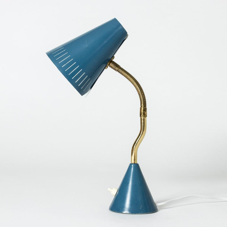 Elegant desk lamp from Falkenbergs Belysning in a beautiful teal color and brass neck. Neat wraparound design of the shade.