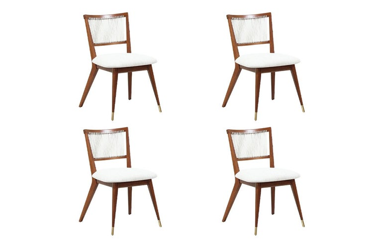 Set of four Mid-Century Modern dining chairs designed by John Keal for Brown Saltman in the United States, circa 1960s. These newly refinished chairs feature a sturdy walnut wood frame with brass sabots at the front legs and new light tweed fabric