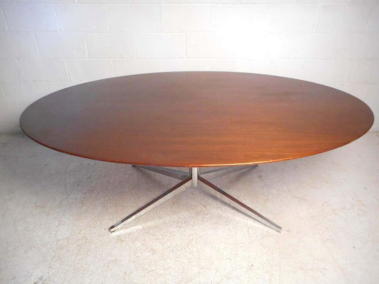 Impressive midcentury dining table by Knoll International. Large wooden tabletop supported by a sturdy chrome base. An impressive addition to any modern interior. Please confirm item location with dealer (NJ or NY).
