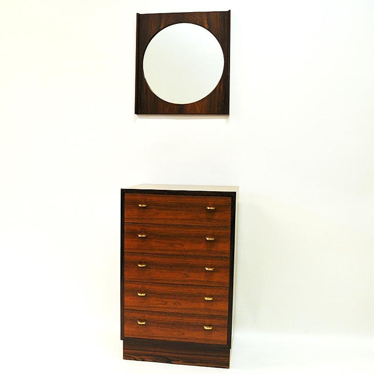 Lovely set 'chest of drawers and hall mirror' of rosewood designed by Torbjørn Afdal, Bruksbo for Mellemstranda Trevareindustri AS, 1950s Norway.
