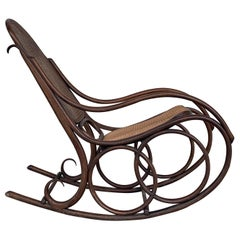 Midcentury Elegant Rattan Rocking Chair in the Thonet Style