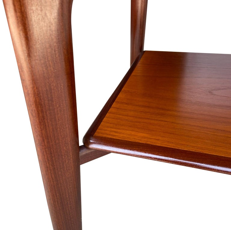 For your consideration are these beautiful and highly crafted Danish tables in teakwood. In amazing original condition showing a warm glowing patina. Designed by Svend Aage Madsen.  Shelf is 9'' high from floor.